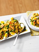 Rice with salmon, egg and peas
