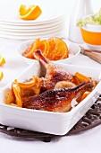Roast duck leg with oranges