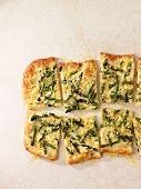 Asparagus pizza cut into slices
