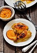Chicken leg with oranges