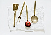 Various old kitchen utensils and a tomato