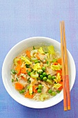 Noodle soup with chicken, celery, carrots and peas (Asia)