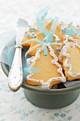 Christmas tree biscuits with ribbons for hanging up