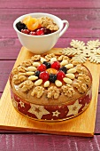 A fruitcake with almonds and walnuts