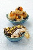Star shaped biscuits decorated with chocolate and pistachios and vol au vents filled with mincemeat