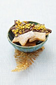 Star-shaped biscuits decorated with chocolate and pistachios