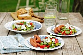 Frankfurters with a bean and pepper salad and goat's cheese