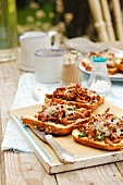 Toast topped with chanterelle mushrooms, herbs and cheese