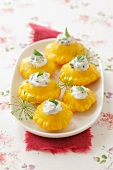 Pickled pattypan squashes filled with cream cheese and basil
