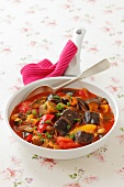 Aubergine and pepper stew with tomatoes