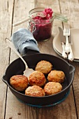 Pork and chicken burgers and red cabbage salad