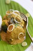 Curry served on banana leaf