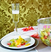 Plates of salad and glasses of champagne on a table