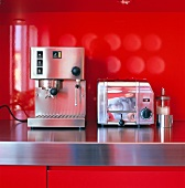An espresso machine and a toaster in a kitchen