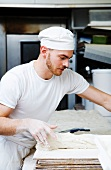 A backer working in a bakery