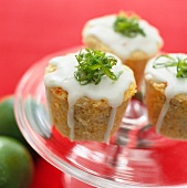 Almond cakes with icing and lime zest