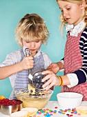 Children baking muffins