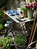 Set side table in a flowering garden