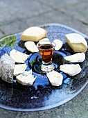 A cheese platter with a glass of sherry