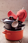 Pots, a wooden spoon and pot holders
