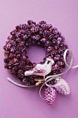 A Christmas wreath and Christmas tree decorations