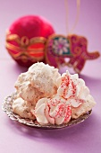 Macaroons and meringues on a silver plate
