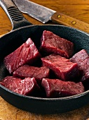 Cubed venison in frying pan
