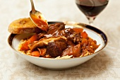 Bowl of Hearty Lamb Stew with Spoon and Bread
