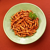 Plate of Gemelli Pasta in Marinara Sauce with Parsley Garnish