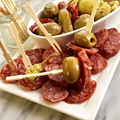 Fuet Salami Slices with Green Olives and Peppers; With Wooden Toothpicks