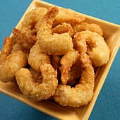 Battered Fried Shrimp in a Yellow Bowl on a Blue Background