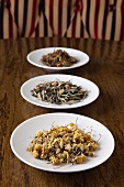 Three Dishes of Loose Tea; Chamomile, Green Tea with Orange and Black Tea