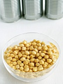 Bowl of Chickpeas Soaking in Water; Cans
