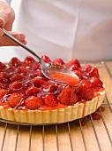 Glazing a strawberry tart