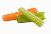 Two Celery Sticks and a Carrot Stick on a White Background