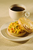 Scrambled Egg Breakfast Sandwich on a Biscuit with a Cup of Coffee