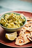 Chunky Guacamole with Tortillas and Lemon