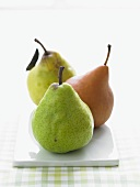 Three Assorted Pears in a Row on Rectangular Dish