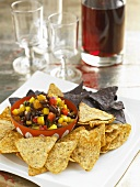 Bowl of Black Bean Salsa with Yellow and Blue Corn Chips