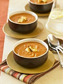Bowls of Creamy Pumpkin Soup with Croutons