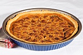 Pecan pie in a baking dish