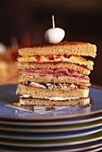 Club sandwich on stack of plates