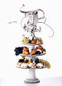 Original cake stand with pastries and fruit