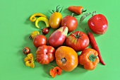 Still-life of summer vegetables with tomatoes, peppers and chilli peppers