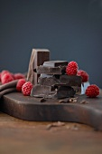 Pieces of chocolate and raspberries