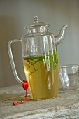 Herb infusion in glass teapot