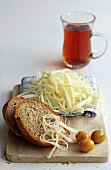 Bread with Cecil cheese (stringy Balkan cheese) and olives