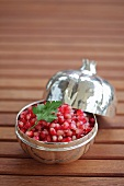 Pomegranate and onion salad in silver bowl