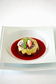 Strawberry dessert with fruit sauce