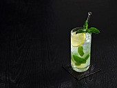 Cool Collins drink with sparkling wine, mint and lemon juice